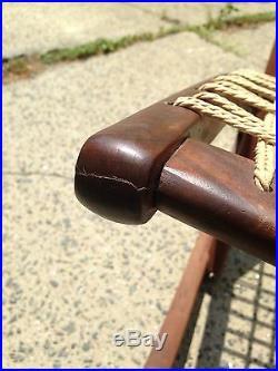 Rare mid century Danish modern rocking chair in the style of Fredrik Kayser